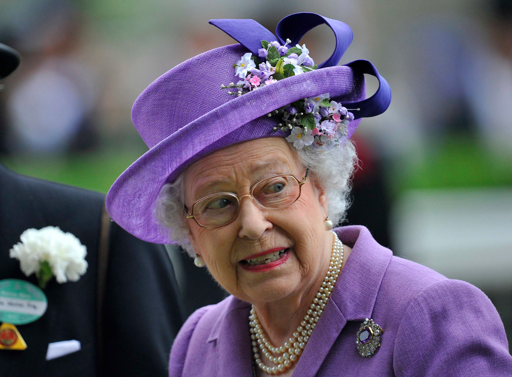. Britain\'s Queen Elizabeth smiles as she looks at the horses in the parade ring during ladies\' day at the Royal Ascot horse racing festival at Ascot, southern England, June 20, 2013.  Big hats and fancy frocks are an integral part of Royal Ascot and organisers of Britain\'s glamorous racehorse meeting want to keep it that way by charging for fashion failures this year. REUTERS/Toby Melville