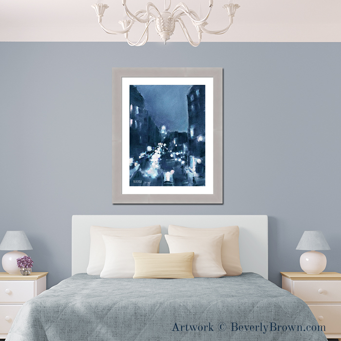 """Modern gray bedroom with New York wall art over the bed. The painting """"Across 23rd Street"""" captures New York at night in shades of midnight blue, aqua and pink. From an original pastel painting by New York artist Beverly Brown. Framed prints and canvas art for sale at www.beverlybrown.com"""