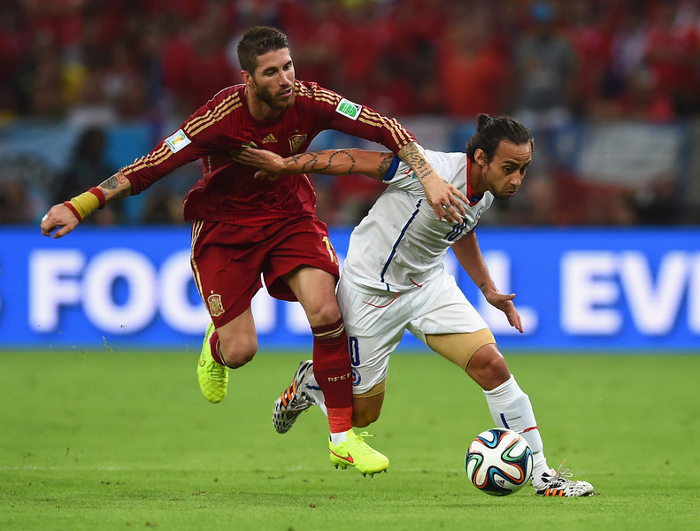. Jorge Valdivia of Chile controls the ball against Sergio Ramos of Spain during the 2014 FIFA World Cup Brazil Group B match between Spain and Chile at Maracana on June 18, 2014 in Rio de Janeiro, Brazil.  (Photo by Matthias Hangst/Getty Images)