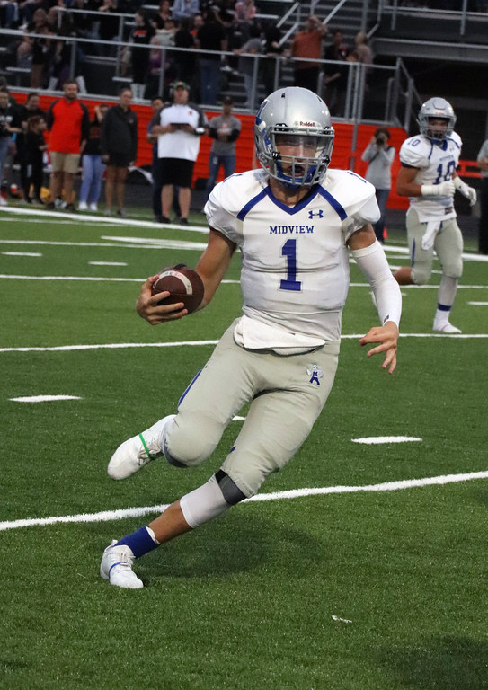 . Nicholas Pfeifer - The Morning Journal<br> Midview quarterback Andrew Gooch rolls out on the QB sweep looking to pick up some critical yards on third down against North Olmsted on Sept. 7.