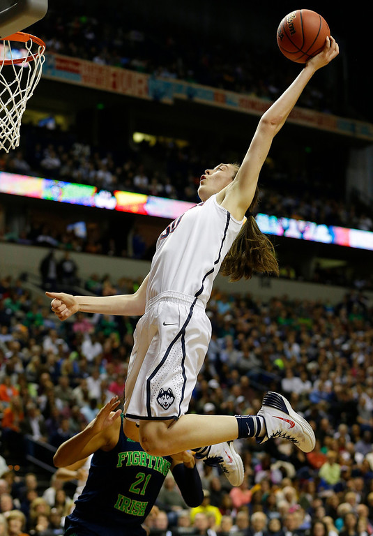 . Connecticut forward Breanna Stewart (30) shoots against Notre Dame guard Kayla McBride (21) during the first half of the championship game in the Final Four of the NCAA women\'s college basketball tournament, Tuesday, April 8, 2014, in Nashville, Tenn. (AP Photo/Mark Humphrey)