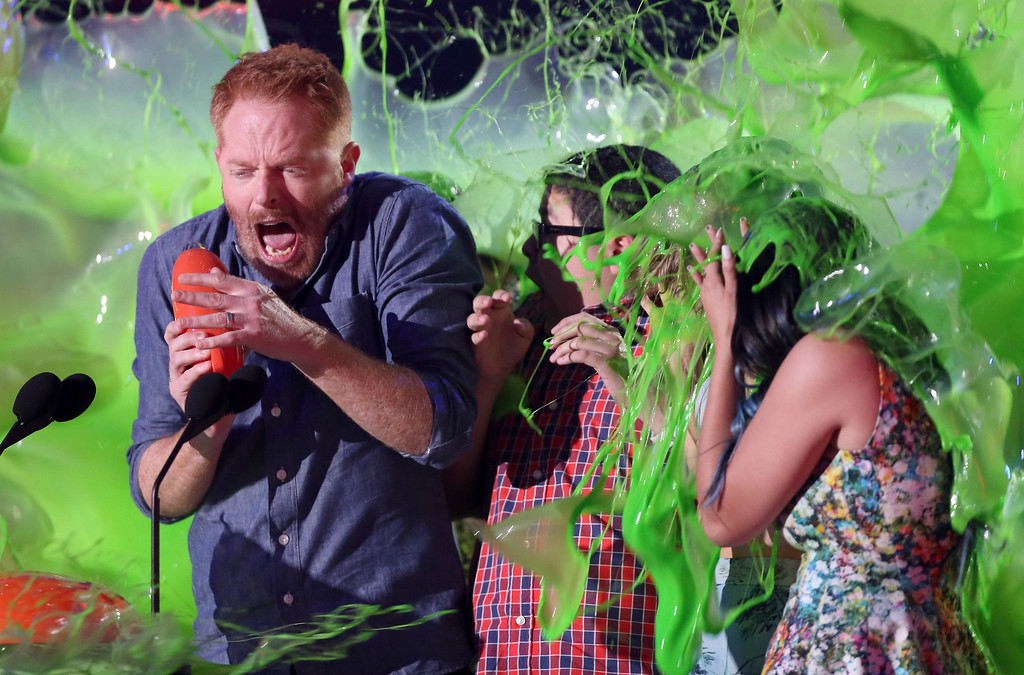 . Jesse Tyler Ferguson, from left, Rico Rodriguez and Ariel Winter are slimed after being announced winners of the award for favorite family TV show for ìModern Familyî at Nickelodeon\'s 28th annual Kids\' Choice Awards at The Forum on Saturday, March 28, 2015, in Inglewood, Calif. (Photo by Matt Sayles/Invision/AP)