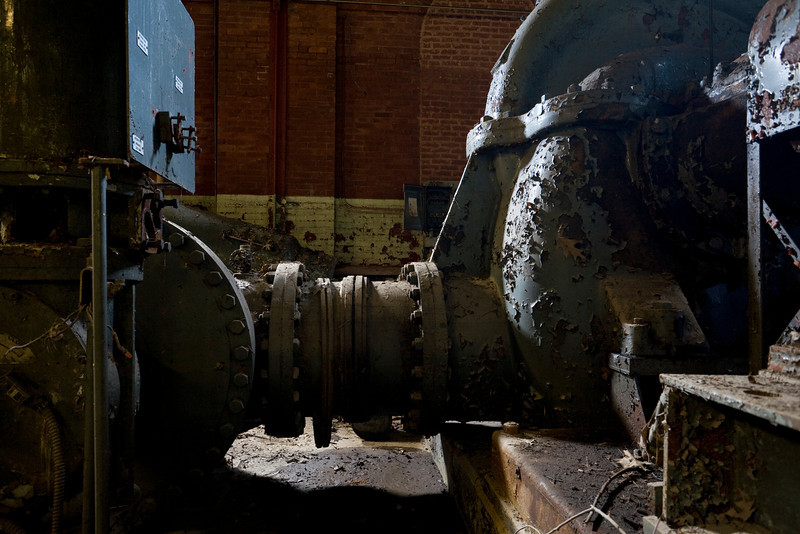 Pipe connecting machines in engine house, photographed during civil twilight.
