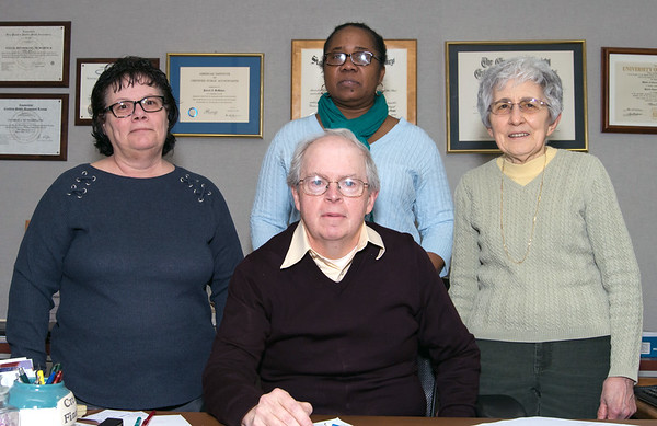Employees of Fulco, DiTommaso, McMahon & Co. Patrick McMahon C.P.A , seated, Accountant Lynn Belval, L, Receptionist Valeria Hubert, and Secretary Judy DiTommaso. | Wesley Bunnell | Staff
