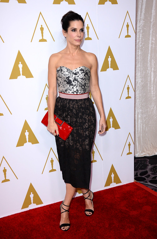 . Sandra Bullock arrives at the 86th Oscars Nominees Luncheon, on Monday, Feb., 10, 2014 in Beverly Hills, Calif. (Photo by Jordan Strauss/Invision/AP)