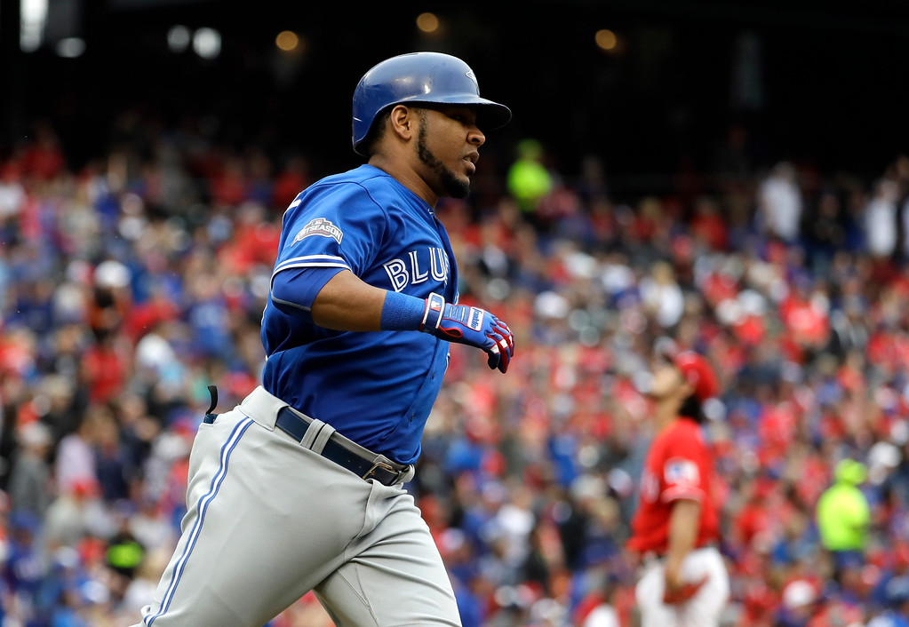 . Toronto Blue Jays\' Edwin Encarnacion rounds the bases after hitting a solo home run off of Texas Rangers\' Yu Darvish in the fifth inning of Game 2 of baseball\'s American League Division Series, Friday, Oct. 7, 2016, in Arlington, Texas. (AP Photo/David J. Phillip)