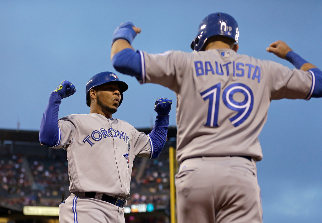 . FILE -  This May 9, 2016 file photo shows Toronto Blue Jays\' Edwin Encarnacion, left, celebrating with Jose Bautista (19) after hitting a two run home run off San Francisco Giants\' Jake Peavy in the third inning of a baseball game in San Francisco. Bautista and Encarnacion were among 10 players to receive $17.2 million qualifying offers from their teams Monday, Nov. 7, 2016 as general managers gathered for their annual meeting. (AP Photo/Ben Margot, file)