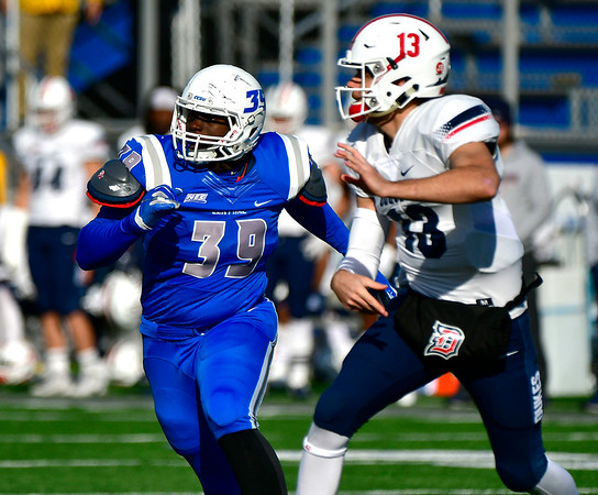 11/17/2018 Mike Orazzi | Staff CCSU's Niam Coward (39) and Duquesne's Daniel Parr (13) at Arute Field in New Britain Saturday afternoon.