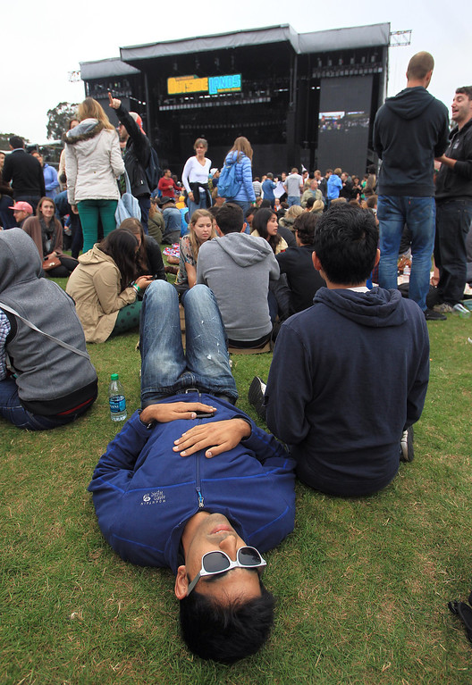 . A festivalgoer chills out before Paul McCartney\'s three-plus hour set at the Land\'s End main stage during the 6th annual Outside Lands Music and Arts Festival in Golden Gate Park in San Francisco, Calif., on Friday, Aug. 9, 2013.  (Jane Tyska/Bay Area News Group)