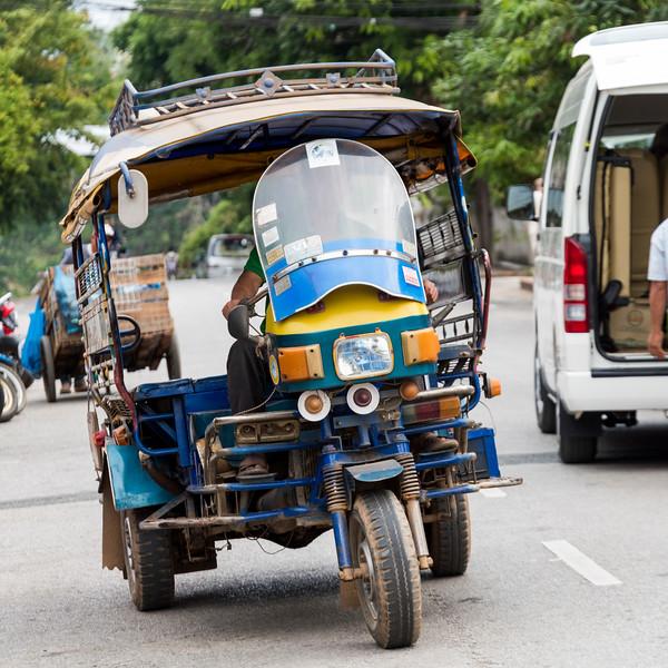 Motorized Tuk Tuk and Vehicles on road, Luang Prabang, Laos