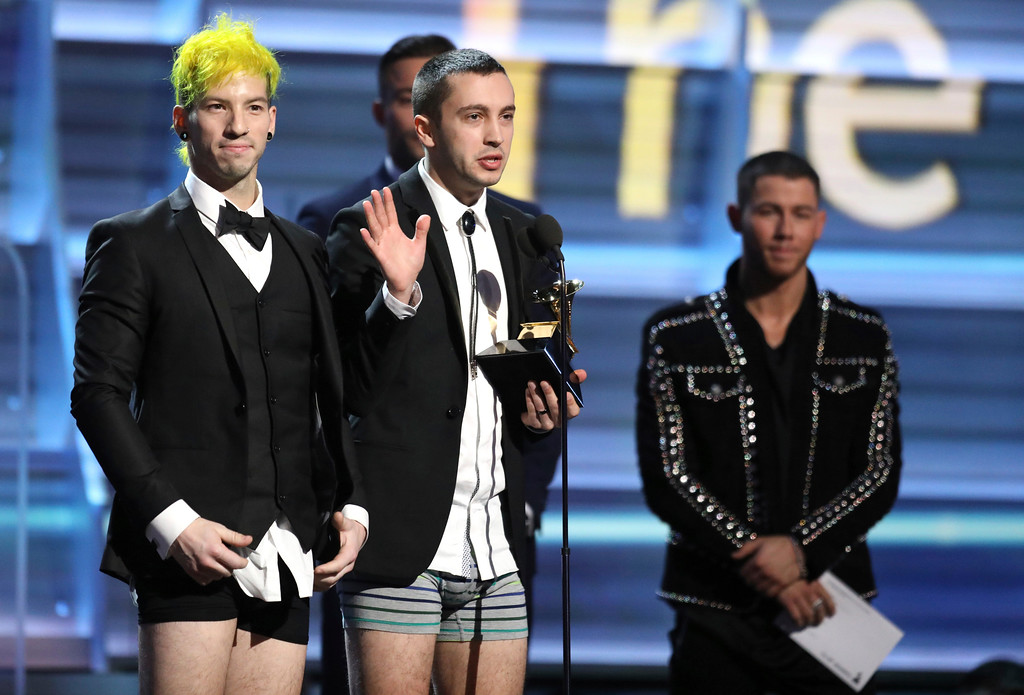 ". Josh Dun, left, and Tyler Joseph of ""Twenty One Pilots\"" appear onstage without pants to accept the award for best pop duo/group performance for \""Stressed Out\"" at the 59th annual Grammy Awards on Sunday, Feb. 12, 2017, in Los Angeles. (Photo by Matt Sayles/Invision/AP)"