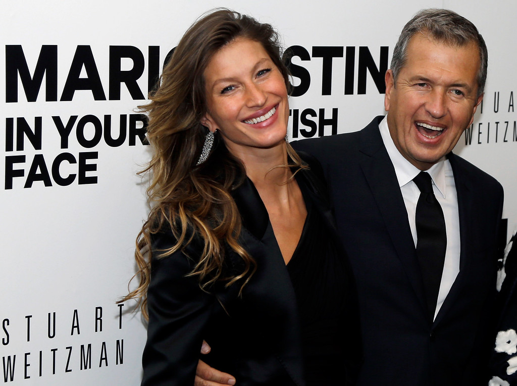 """. Super model Gisele Bundchen poses with photographer Mario Testino prior to an evening reception at the Museum of Fine Arts in Boston Wednesday, Oct. 17, 2012 for the U.S. exhibitions of Testino\'s photographs \""""In Your Face\"""" and \""""British Royal Portraits.\"""" (AP Photo/Elise Amendola)"""