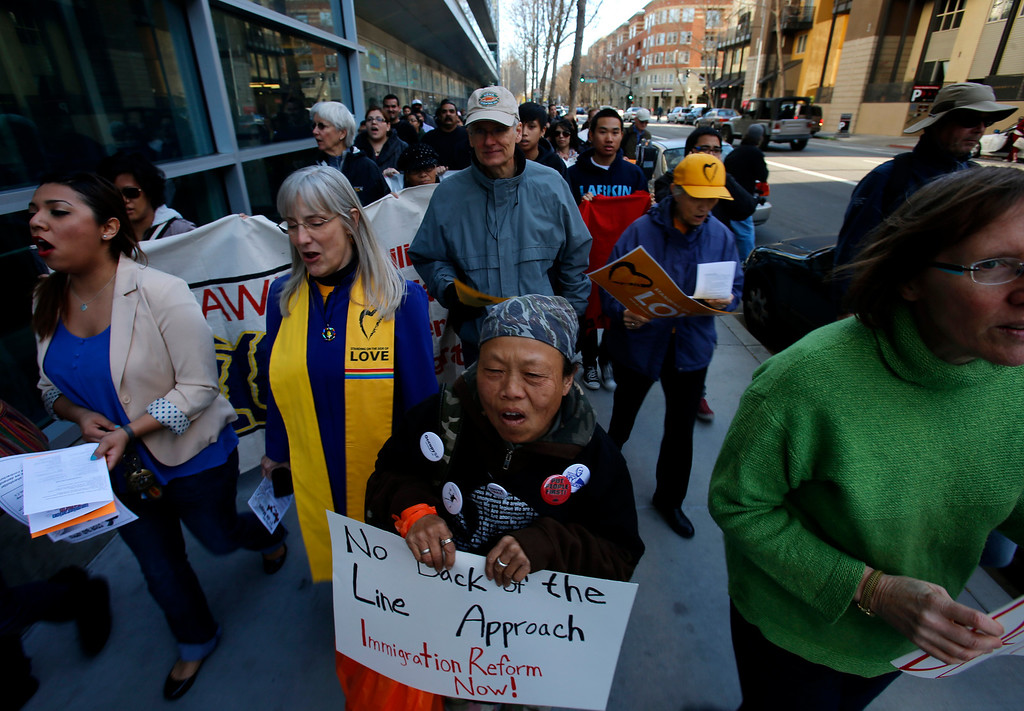 ". Protestors march north on S. 4th St. during an ""Immigration Reform Now\"" rally in San Jose, Calif., on Thursday, Feb. 21, 2013.  They were protesting comprehensive immigration reform.  They began at Dr. Martlin Luther King, Jr. Library and ended at the Robert F. Peckham Federal Building.  (Nhat V. Meyer/Staff)"