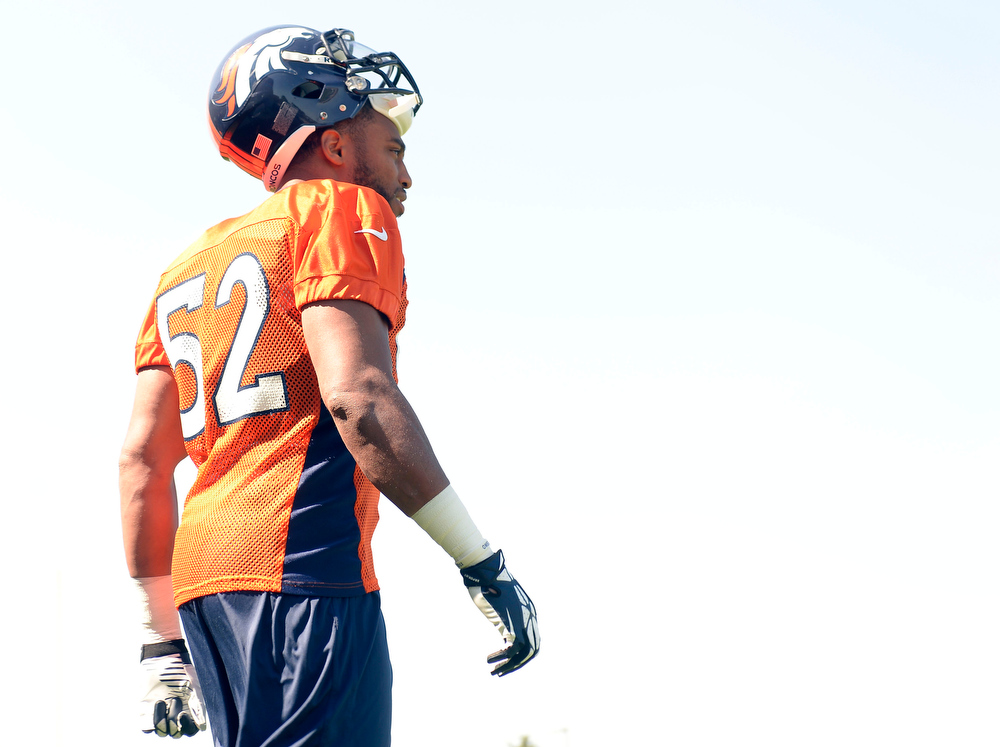 . Denver Broncos Wesley Woodyard (52) walks out to the field during training camp July 26, 2013 at Dove Valley. (Photo By John Leyba/The Denver Post)