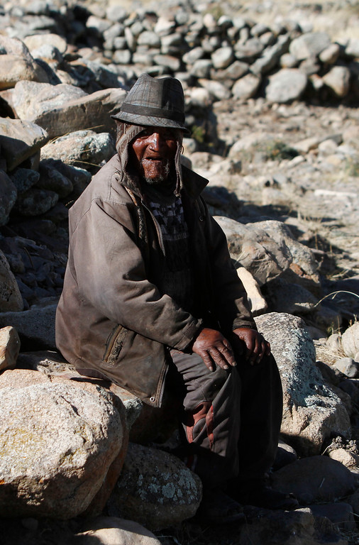 . Carmelo Flores Laura, a native Aymara, sits outside in his village of Frasquia, Bolivia, Tuesday, Aug. 13, 2013. If Bolivia�s public records are correct, Flores is the oldest living person ever documented. They say he turned 123 a month ago. Flores said he sorely misses his wife, who died more than a decade ago. (AP Photo/Juan Karita)