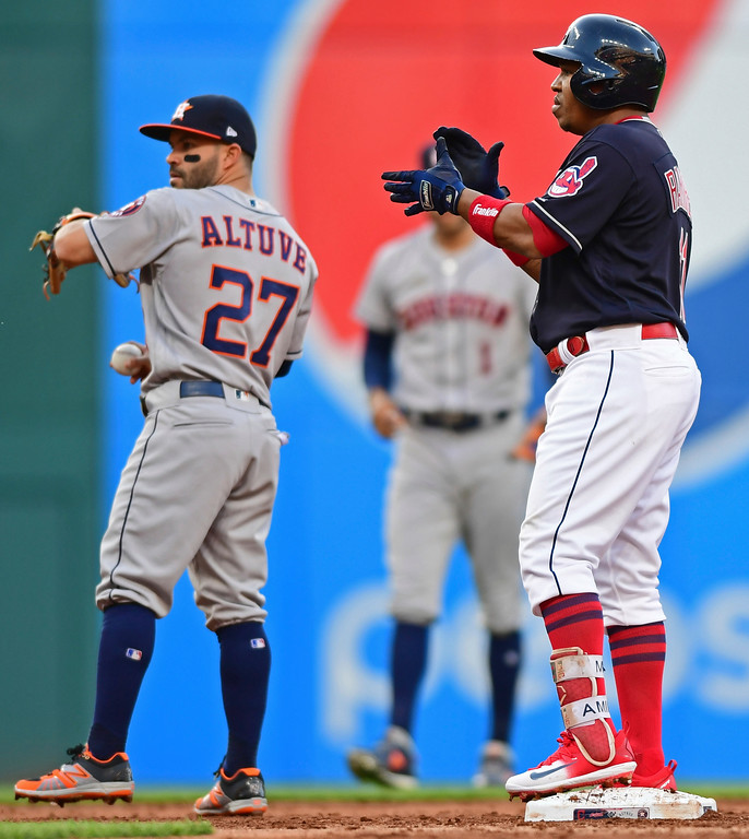 . Cleveland Indians\' Jose Ramirez celebrates after hitting an RBI-double during the third inning of a baseball game against the Houston Astros, Friday, May 25, 2018, in Cleveland. (AP Photo/David Dermer)