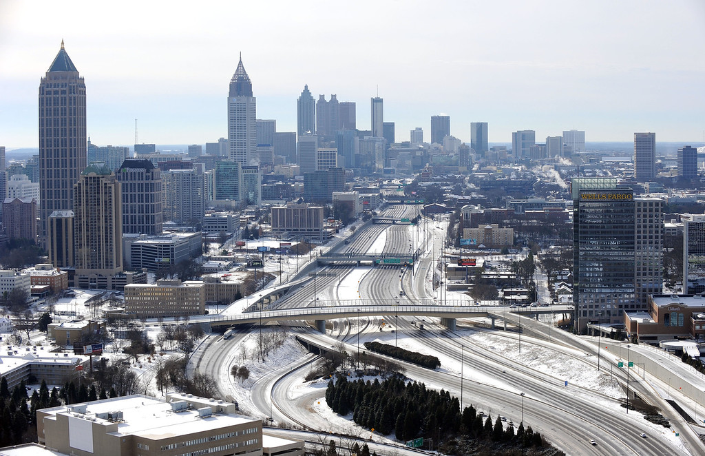 . In this view looking south toward downtown Atlanta, the ice-covered interstate system is empty after a winter snow storm   slammed the city with over 2 inches of snow that turned highways into parking lots when motorists abandoned their vehicles creating massive traffic jams lasting through Wednesday, Jan. 29, 2014, in Atlanta. While such amounts of accumulation barely qualify as a storm in the north, it was enough to paralyze the Deep South. (AP Photo/David Tulis)
