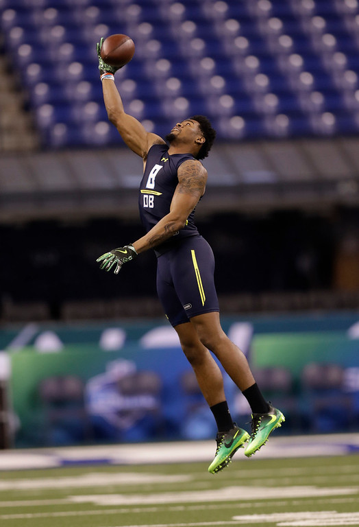 . Ohio State defensive back Gareon Conley runs a drill at the NFL football scouting combine Monday, March 6, 2017, in Indianapolis. (AP Photo/David J. Phillip)