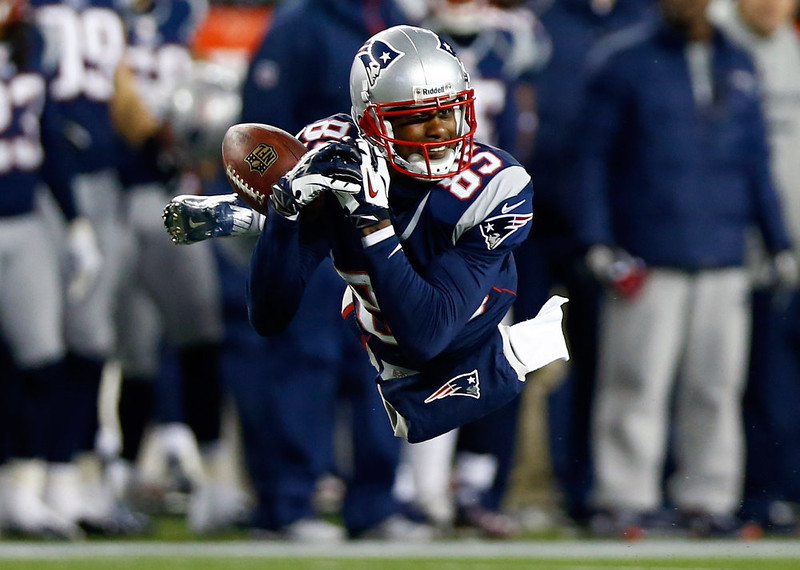 . Brandon Lloyd #85 of the New England Patriots misses a catch against the Baltimore Ravens during the 2013 AFC Championship game at Gillette Stadium on January 20, 2013 in Foxboro, Massachusetts.  (Photo by Jared Wickerham/Getty Images)