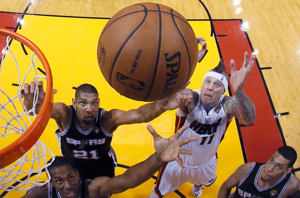 . Miami Heat power forward Chris Andersen (11) and San Antonio Spurs power forward Tim Duncan (21) reach up for a rebound during Game 6 of their NBA Finals basketball playoff in Miami, Florida June 18, 2013. REUTERS/Kevin C. Cox/Pool