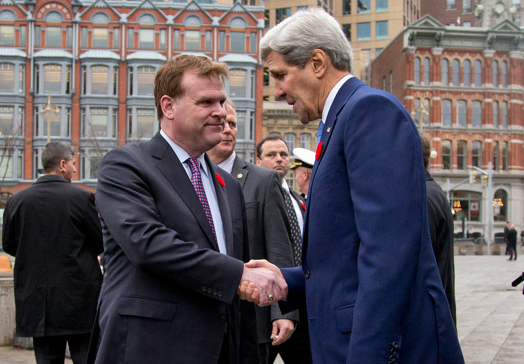 . Secretary of State John Kerry and Canadian Foreign Minister John Baird shake hands after Kerry placed a wreath at the Tomb of the Unknown Soldier during a ceremony at the National War Memorial in Ottawa, Canada, Tuesday, Oct. 28, 2014. (AP Photo/Carolyn Kaster, Pool)