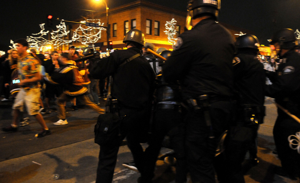 . Minneapolis police disperse fans gathered blocking an intersection in Dinkytown. (Pioneer Press: Sherri LaRose-Chgilo)
