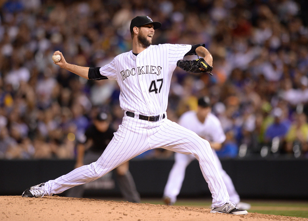 . DENVER, CO - JUNE 20: Colorado reliever Chris Martin found little success in his sixth inning performance Friday night. The Colorado Rockies hosted the Milwaukee Brewers at Coors Field Friday night, June 20, 2014. Photo by Karl Gehring/The Denver Post