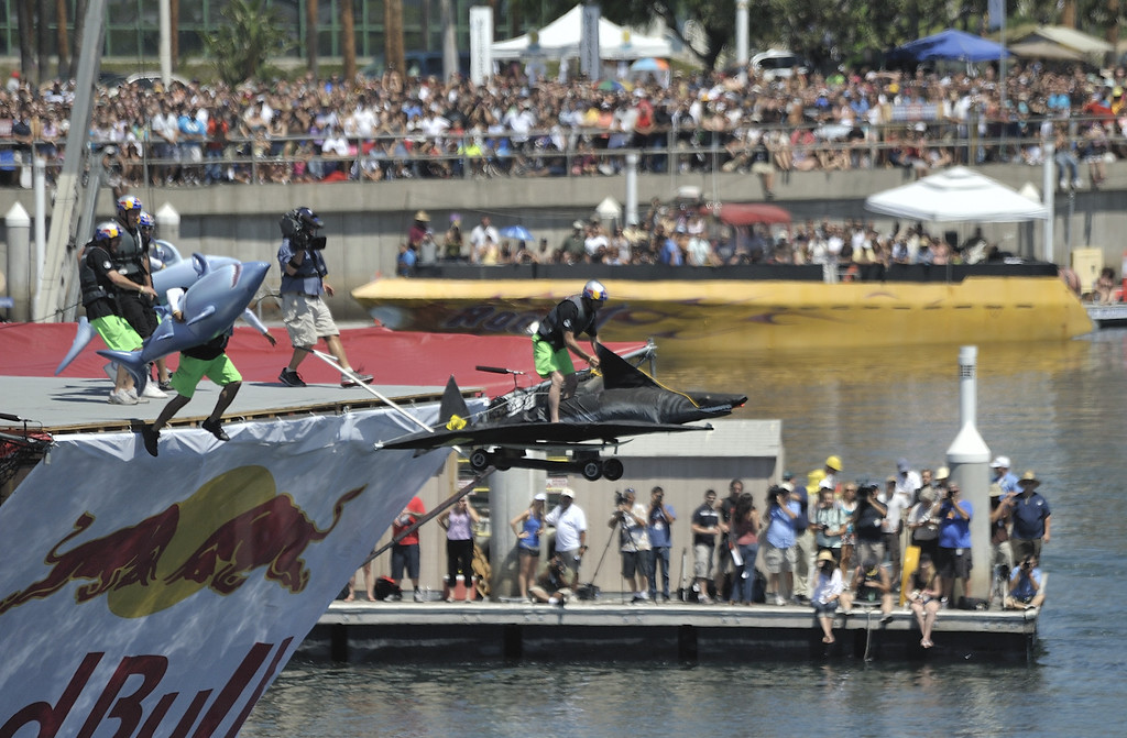 """. LONG BEACH, CALIF. USA -- Dan Brill pilots \""""Kirby Extreme Team\"""" during the Flugtag in Rainbow Harbor in Long Beach, Calif. on August 21, 2010. Thirty five teams competed in the Red Bull event where teams build homemade, human-powered flying machines and pilot them off a 30-foot high deck in hopes of achieving flight.  Flugtag means \""""flying day\"""" in German. They are on distance, creativity and showmanship..Photo by Jeff Gritchen / Long Beach Press-Telegram.."""