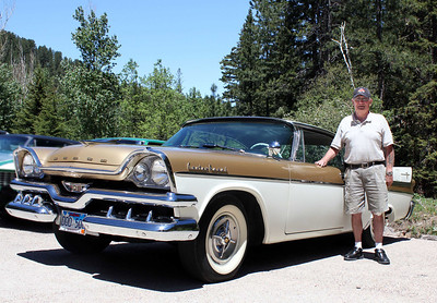 Fresh from his doughnut duties on Saturday, we ran across Lion Gerald Keil just outside of Lead on Sunday, touring the Hills in his classic Dodge Classic Royal.