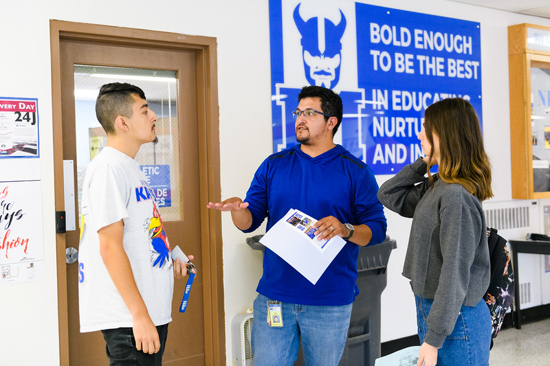 Jose Zavala, center, helps students with their schedules. Back to school day at McNary High School on Wednesday, September 4, 2019 in Keizer, Ore.