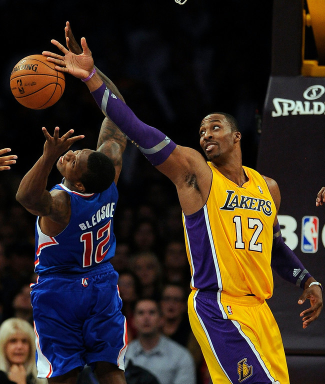 . The Clippers\' Eric Bledsoe #12 and the Lakers\' Dwight Howard #12 go after a rebound during their game at the Staples Center Friday, November 2, 2012. The Clippers beat the Lakers 105-95.  (Hans Gutknecht/L.A. Daily News)