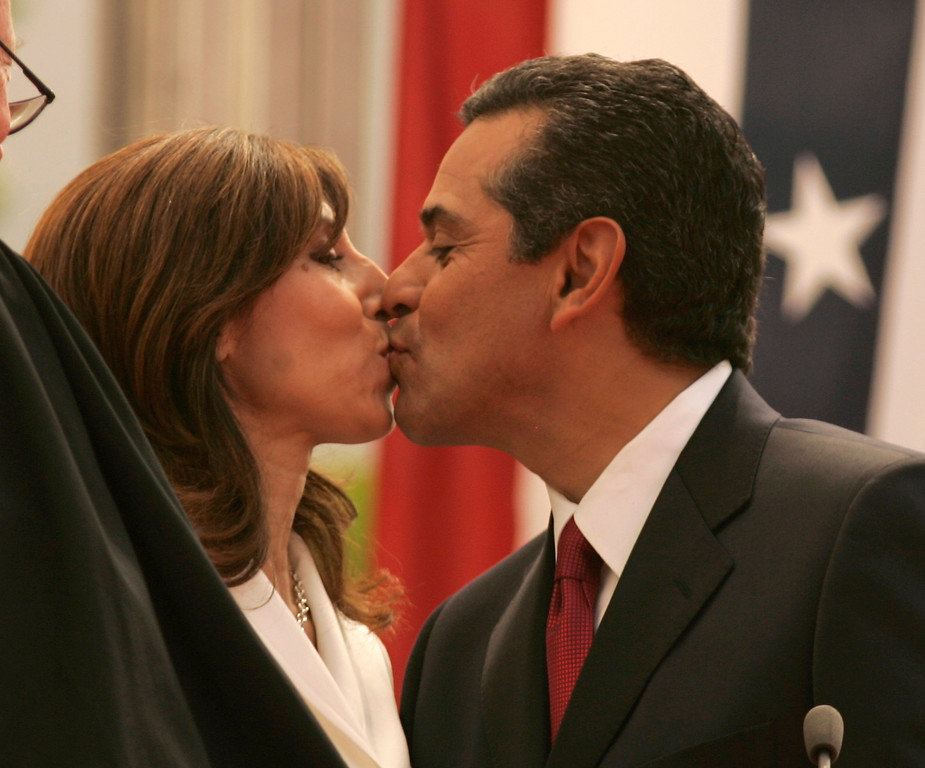 . 7/1/05-LOS ANGELES- Antonio Villaraigosa kisses his wife Corina after he  was inaugurated as Mayor of the city of Los Angeles Friday, with a procession from the Cathedral of Our Lady of Angels to City Hall. He was sworn in by Justice Stephen Reinhardt, from the United States Court of Appeals for the Ninth Circuit, with his wife Corina by his side.  (Los Angeles Daily News file photo)