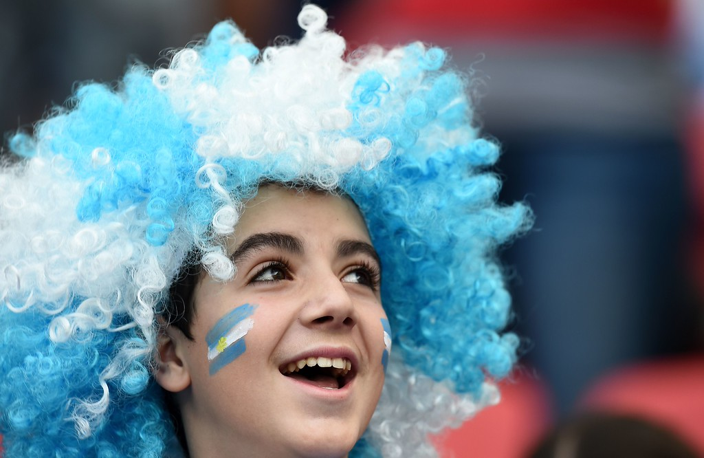 . An Argentinian supporter cheers for their team ahead of the Group F football match between Nigeria and Argentina at the Beira-Rio Stadium in Porto Alegre on June 25, 2014, during the 2014 FIFA World Cup.  AFP PHOTO / JEWEL SAMAD/AFP/Getty Images