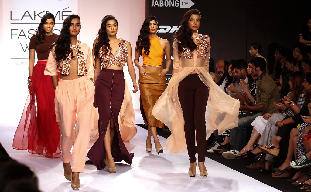 . Models present creations by Indian designer Nikhil Thampi during an opening show of the Lakme Fashion Week Summer/Resort 2014 in Mumbai, India, 12 March 2014. Some 92 designers will be showcasing their collections at the event running from 12 to 16 March.  EPA/DIVYAKANT SOLANKI