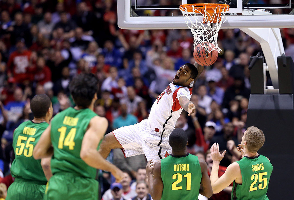 . Chane Behanan #21 of the Louisville Cardinals reacts after he dunked the ball in the first half against the Oregon Ducks during the Midwest Region Semifinal round of the 2013 NCAA Men\'s Basketball Tournament at Lucas Oil Stadium on March 29, 2013 in Indianapolis, Indiana.  (Photo by Streeter Lecka/Getty Images)