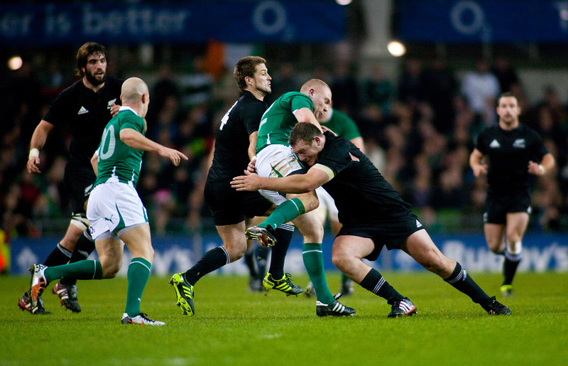 All Black Tony Woodcock tackles Keith Earls during the International rugby test with Ireland against the New Zealand All Blacks at Aviva Stadium Dublin. November 2010