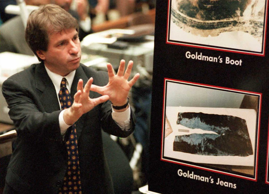 . Defense attorney Barry Scheck gestures during direct examination of forensic expert Dr Henry Lee 23 Aug during the O.J. Simpson murder trial where victim Ron Goldman\'s bloody jeans were entered into evidence.  The defense contends that what appears to be parallel patterns on the left leg of the jeans are shoe imprints from a second assaillant.      (POO/AFP/Getty Images)