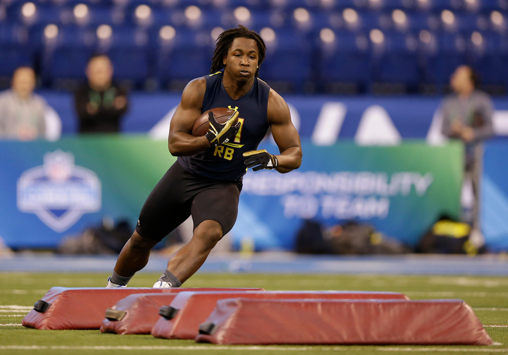 . Toledo running back Kareem Hunt runs a drill at the NFL football scouting combine in Indianapolis, Friday, March 3, 2017. (AP Photo/Michael Conroy)