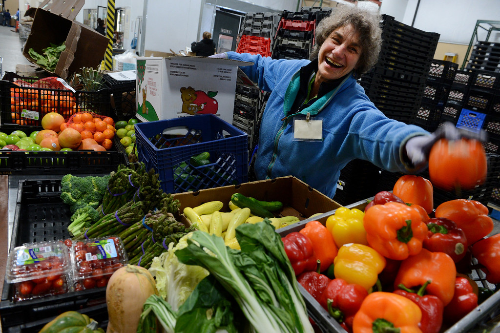 """. Volunteer Janice Zelazo sorts produce at the Community Food Share in Longmont, CO, Thursday December 27, 2012. She says she has volunteered  with the organization for over four years and, \""""it serves an incredibly important need.\""""  Craig F. Walker, The Denver Post"""