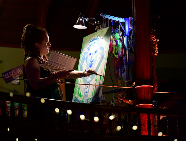 3/30/2019 Mike Orazzi | Staff Lee Gee paints above the rotunda Stage during Swan Day CT held at Trinity on Main in New Britain Saturday night.