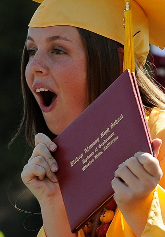 . Catherine Flavin celebrates after getting her diploma. The Commencement Exercises for the Bishop Alemany High School Class of 2013 was held at College of the Canyons in Santa Clarita, CA 6/1/2013(John McCoy/LA Daily News)