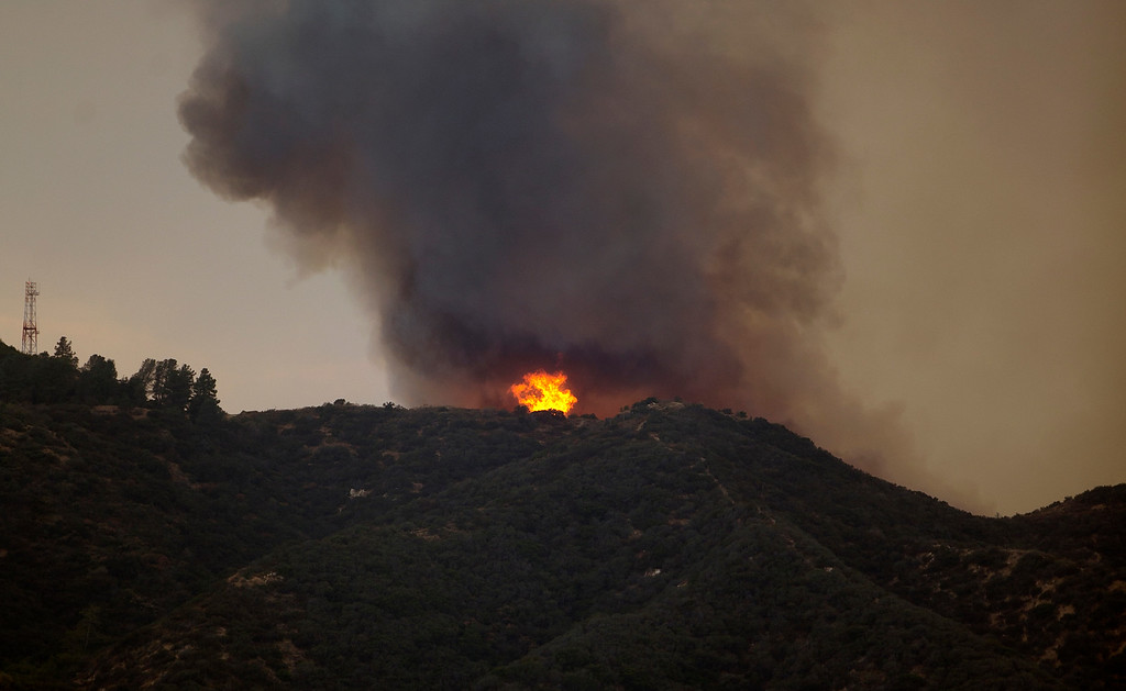 . A plume of smoke is seen from the 210 Freeway as a brush fire burns in the top of the Verdugo Mountains in the Sun Valley neighborhood of Los Angeles. (AP Photo/Damian Dovarganes)