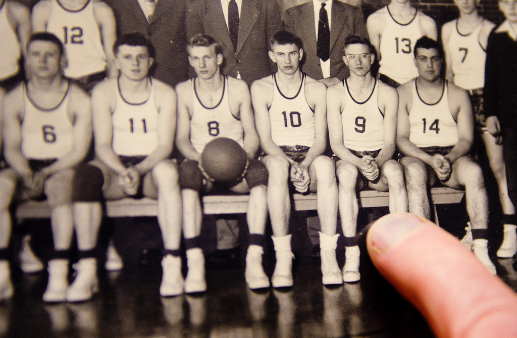 . Chisholm boys basketball coach Bob McDonald points to a photo of himself on the 1950 Chisholm High School basketball team. (Pioneer Press: Ben Garvin)