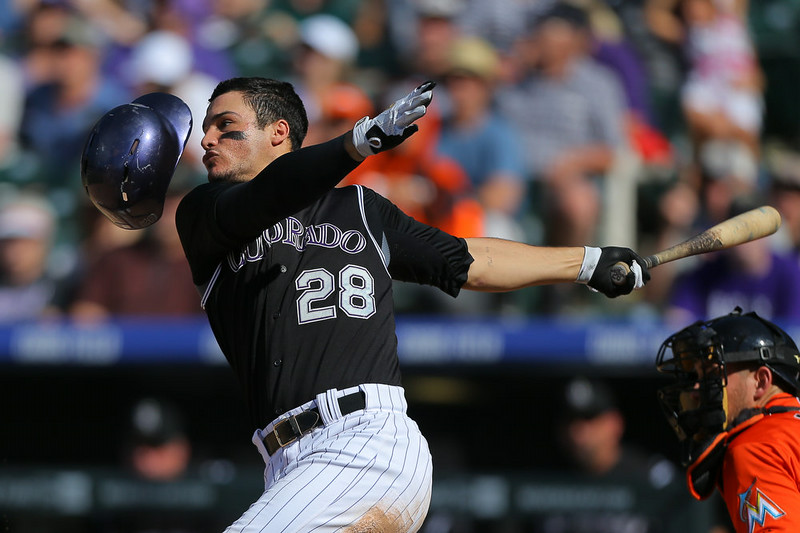 . Nolan Arenado #28 of the Colorado Rockies loses his helmet en route to grounding out during the sixth inning against the Miami Marlins at Coors Field on August 24, 2014 in Denver, Colorado. The Rockies defeated the Marlins 7-4. (Photo by Justin Edmonds/Getty Images)