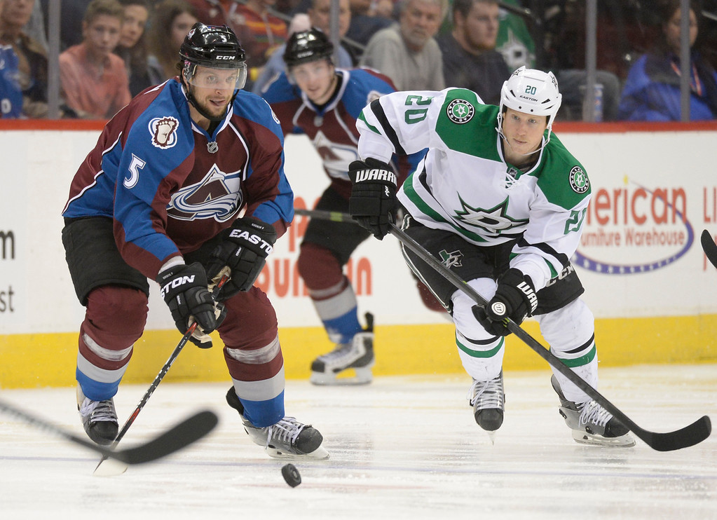 . Colorado Avalanche defenseman Nate Guenin (5) and Dallas Stars center Cody Eakin (20) race for the puck during the second period Saturday, February 14, 2015 at the Pepsi Center in Denver, Colorado. (Photo By Brent Lewis/The Denver Post)