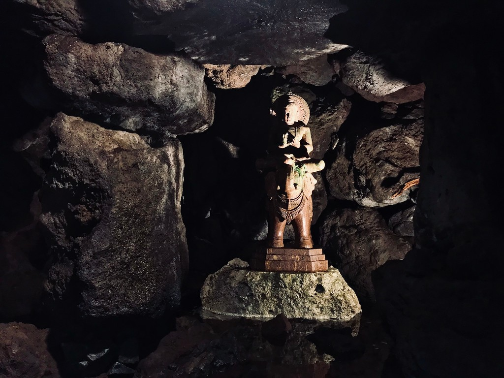A statue inside a cave.