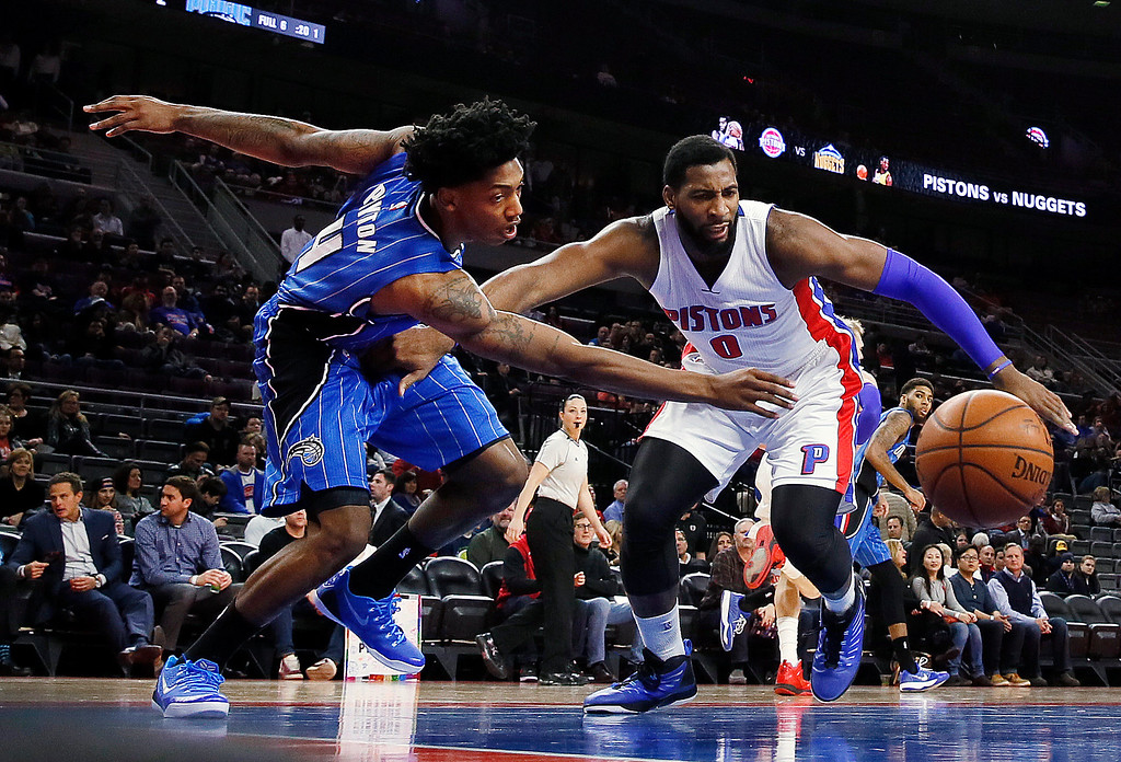 . Orlando Magic guard Elfrid Payton (4) and Detroit Pistons center Andre Drummond (0) chase a ball in the first half of an NBA basketball game in Auburn Hills, Mich., Wednesday, Jan. 21, 2015. (AP Photo/Paul Sancya)