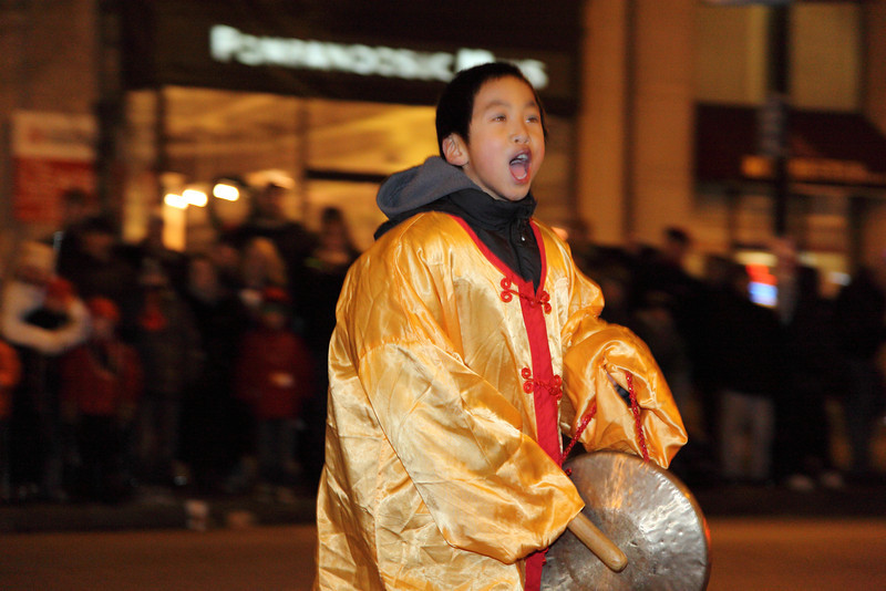 David is running around and saying happy new year to people on the street. Copyright 2012 By Chi-Sun Chan