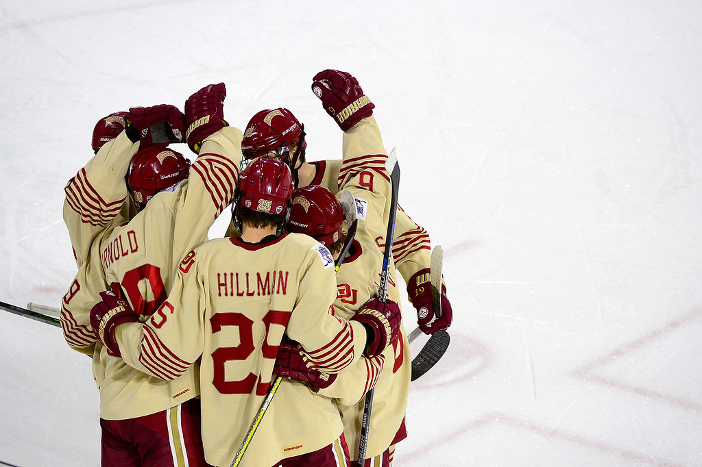 . Denver Pioneers celebrates after a goal during the first period at Magness Arena on March 4, 2016 in Denver, Colorado. (Photo by Brent Lewis/The Denver Post)