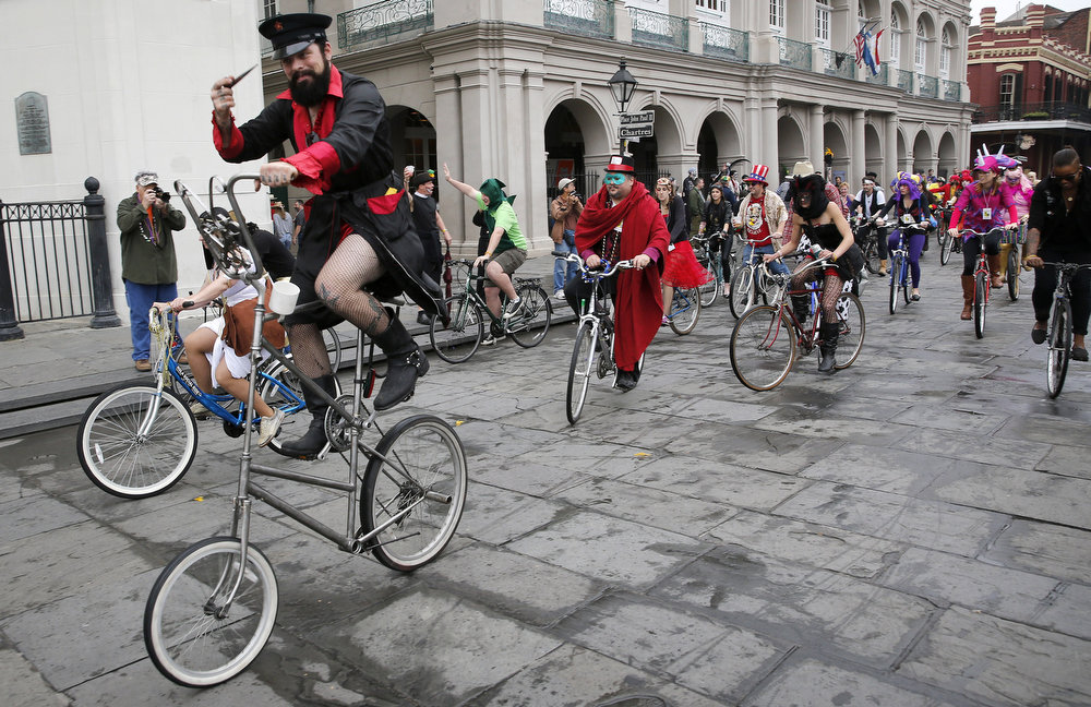 . Members of the Krewe of Bikus roll down Chartres Street on Mardi Gras Day in French Quarter February 12, 2013 in New Orleans, Louisiana. Fat Tuesday, the traditional celebration on the day before Ash Wednesday and the begining of Lent, is marked in New Orleans with parades and marches through many neighborhoods in the city. (Photo by Rusty Costanza/Getty Images)